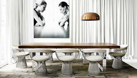 Table surrounded by White Chairs